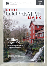 Magazine cover for Ohio Cooperative Living featuring a red mill by a creek